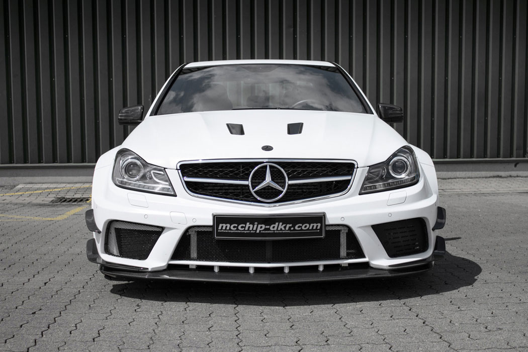 2010 mercedes benz c63 amg mc8xx by mcchip dkr front photo ibis white color size 1050 x 700. Black Bedroom Furniture Sets. Home Design Ideas