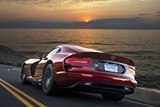 rear, red exterior paint color, sunset