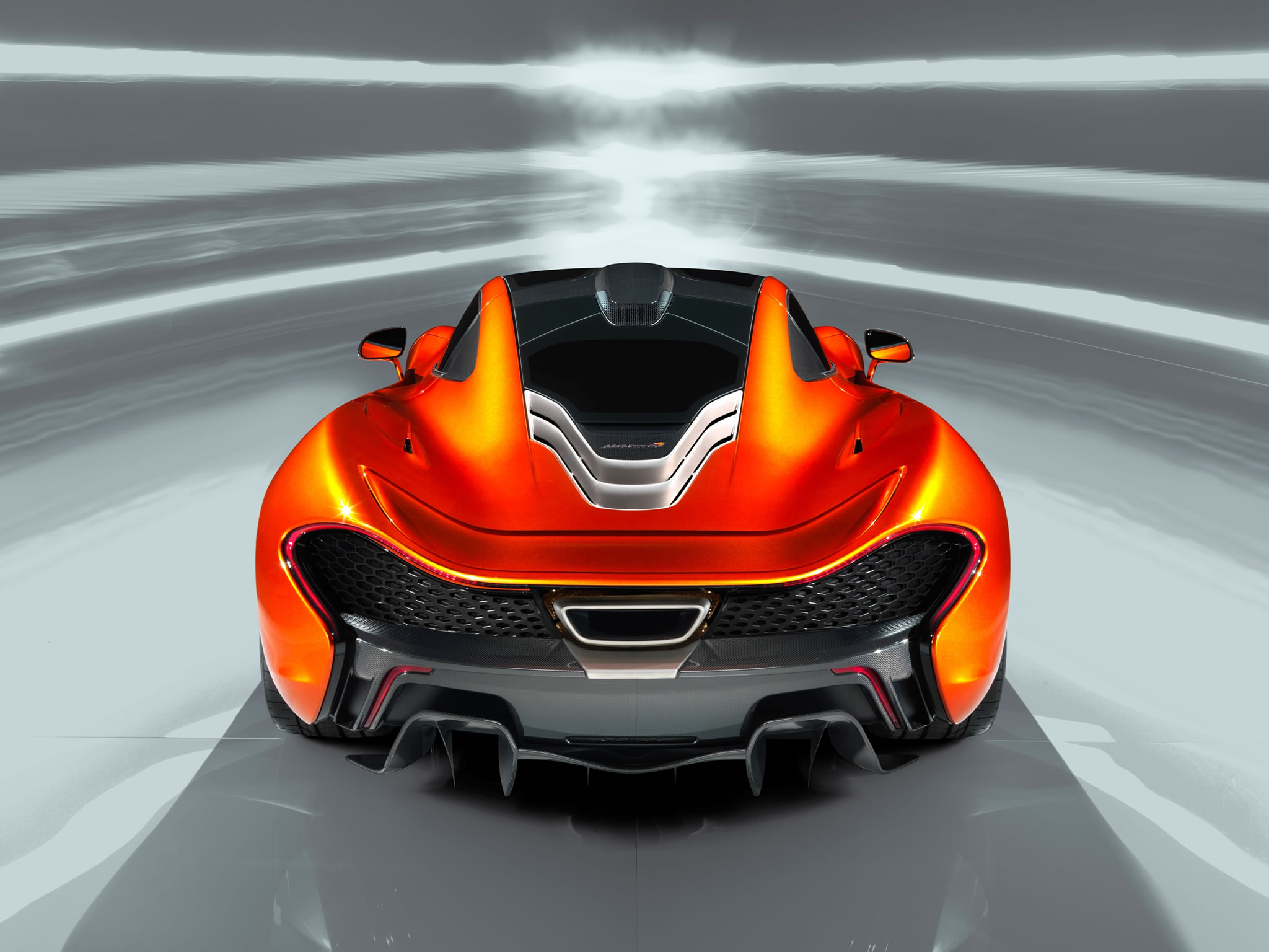 2014 McLaren P1 rear photo Volcano Orange color size 2048 x 1536