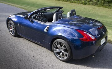 The 2014 370Z Roadster's exterior features an aluminum hood, door panels and 