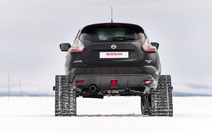 Fitted with 815-pound (370 kilogram) DOMINATOR Track Systems snow tracks, the 