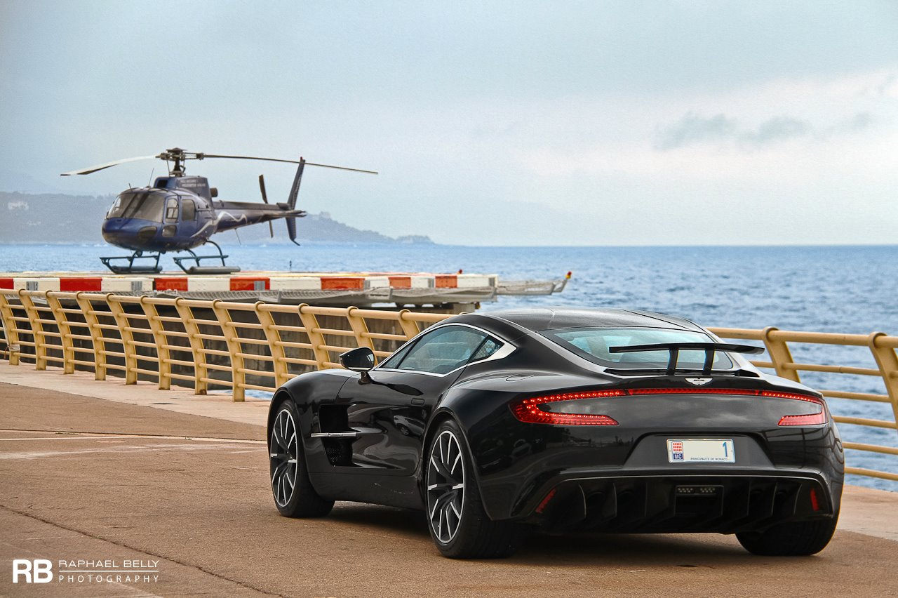 aston martin one 77 in monaco helicopter helipad rear view black color rear wing. Black Bedroom Furniture Sets. Home Design Ideas